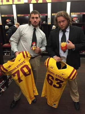 Iowa State linemen Daniel Burton and Ryan Glenn pose with their gold jerseys and unique ties.