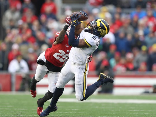 Michigan's Donovan Peoples-Jones makes a catch against Wisconsin in the second quarter Saturday, Nov. 18, 2017 at Camp Randall Stadium in Madison, Wis.