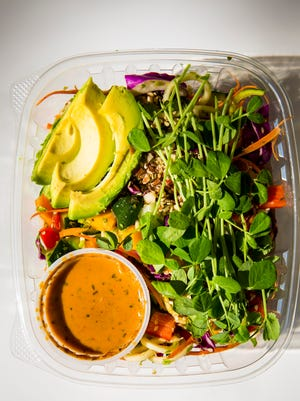 Rooted Juicery + Kitchen offers a rainbow noodle salad in their grab and go section that has zucchini noodles, cabbage, mango, avocado, carrot, cucumber, red pepper, pea shoots, almonds, herbs and thai sauce.