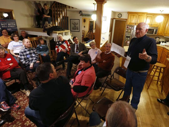 Gary Weaver leads caucusgoers through the process in his home in Rippey, Iowa, during the Iowa caucuses in 2016.