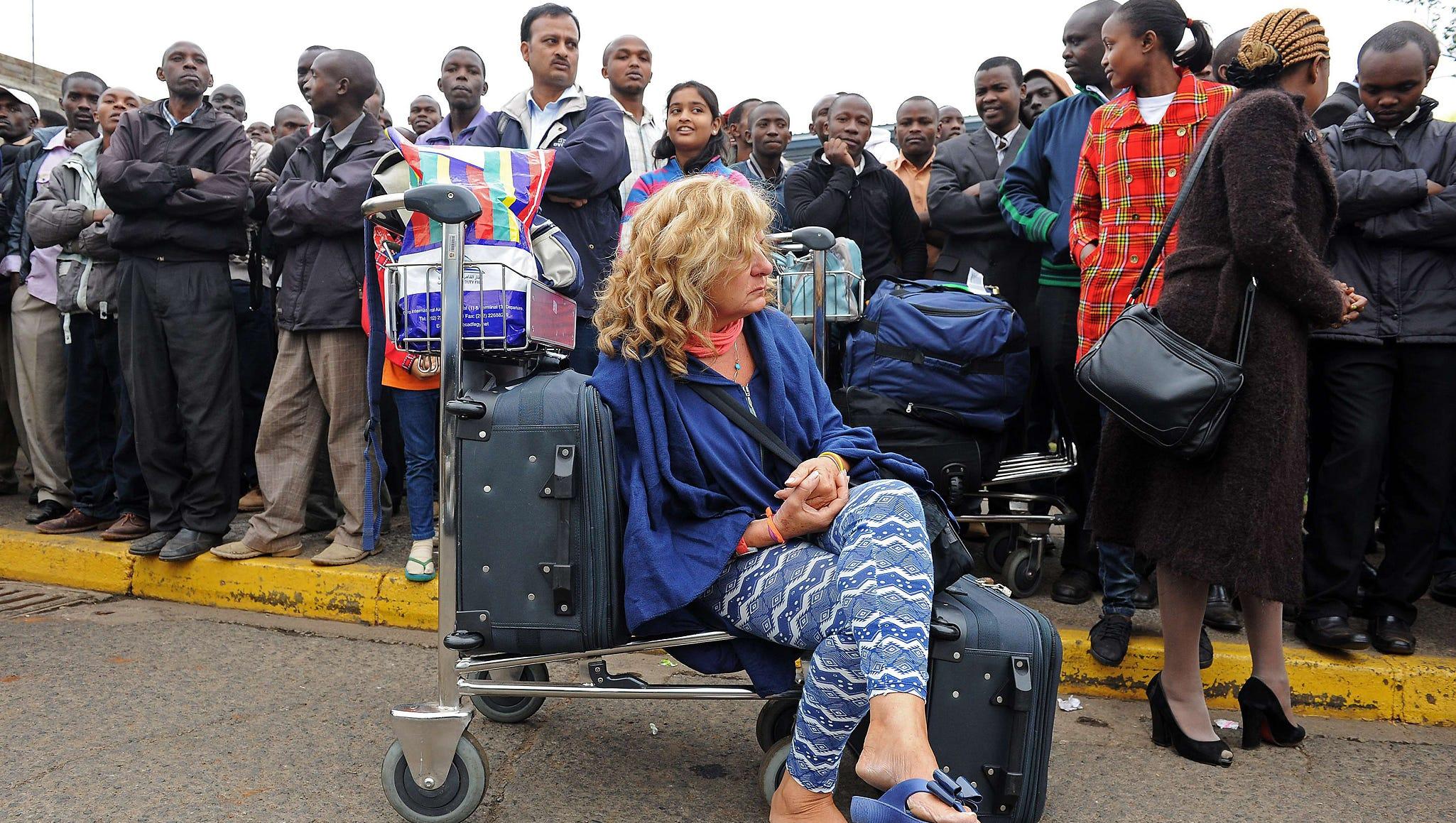Passengers wait outside the Jomo Kenyatta International Airport.