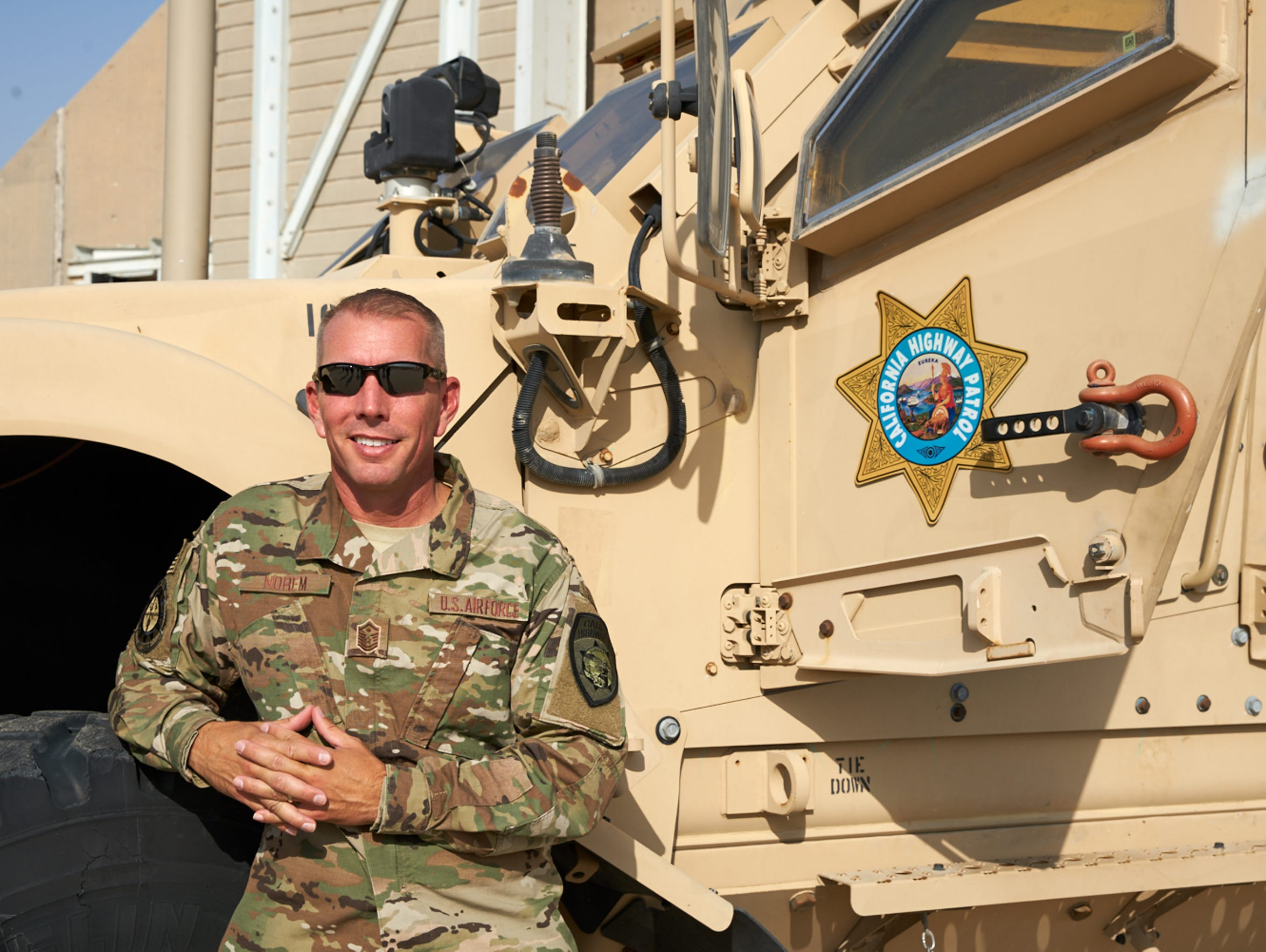 Dane Norem poses with a military vehicle during a recent