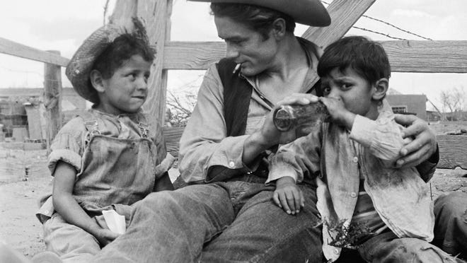 This undated photo provided by courtesy of Richard C. Miller shows, James Dean and two local children on the set of Giant, in Marfa, Texas. A new documentary, Children of Giant, examines the Mexican-American child actors who appeared in the 1956 blockbuster movie Giant but later were forced to view the film in segregated theaters.