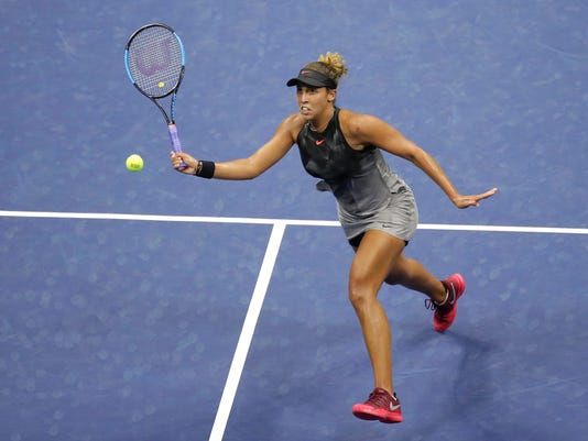 Madison Keys, of the United States, returns to Elena Vesnina, of Russia, during the U.S. Open tennis tournament early Sunday, Sept. 3, 2017, in New York. (AP Photo/Seth Wenig)