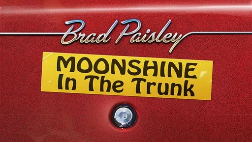 """This CD cover image released by Arista Nashville shows """"Moonshine in the Trunk,"""" by Brad Paisley. Paisley backs away from social issues and strikes up a party on this, his 10th studio album. However, that doesn't mean he suddenly starts to play it safe."""