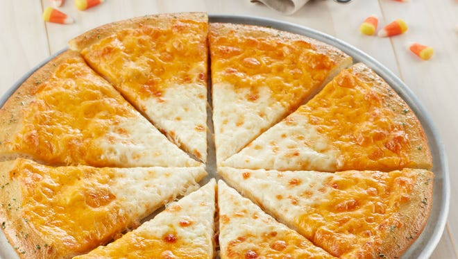Chuck E. Cheese's special Candy Corn Pizza features two colors and varieties of cheese, which mimic the look of the popular Halloween candy.