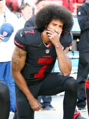 49ers quarterback Colin Kaepernick kneels during the
