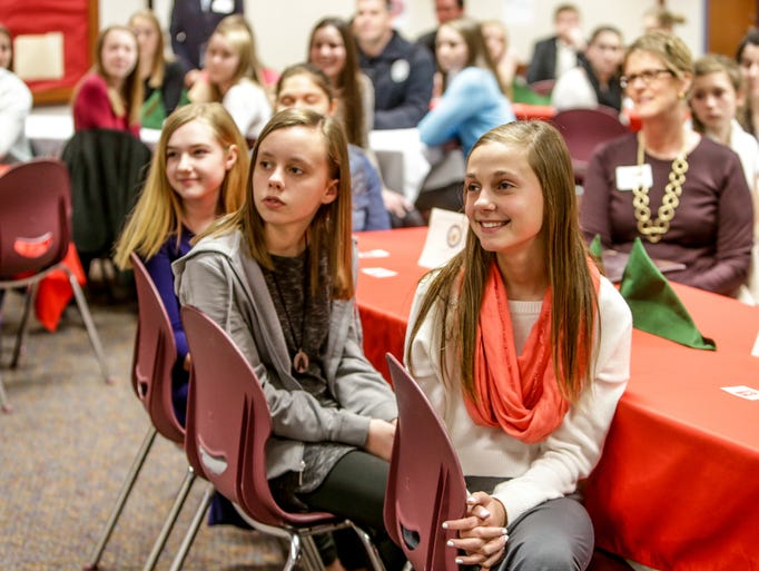 Wednesday March 26th, 2014, (left to right), students, Emma Hendrick, Grace Rosebrough, and Kara Arnold listen as speakers read thank you notes from Sandy Victims. community leaders and students gathered at Clay Middle School, in Carmel, to praise 8th grade physical science students, who raised four thousand dollars for victims of Hurricane Sandy in New Jersey.