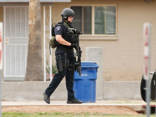 Police stand guard outside Adams Elementary School