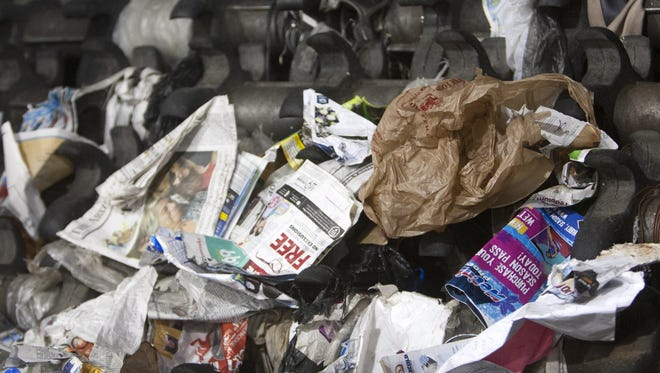 A plastic bag has slipped into a machine sorting cardboard and paper at Phoenix's North Gateway Transfer Station.