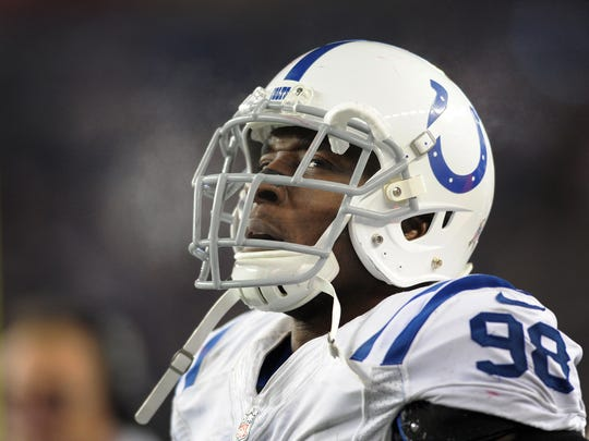 A dejected DE Robert Mathis lets off some steam late
