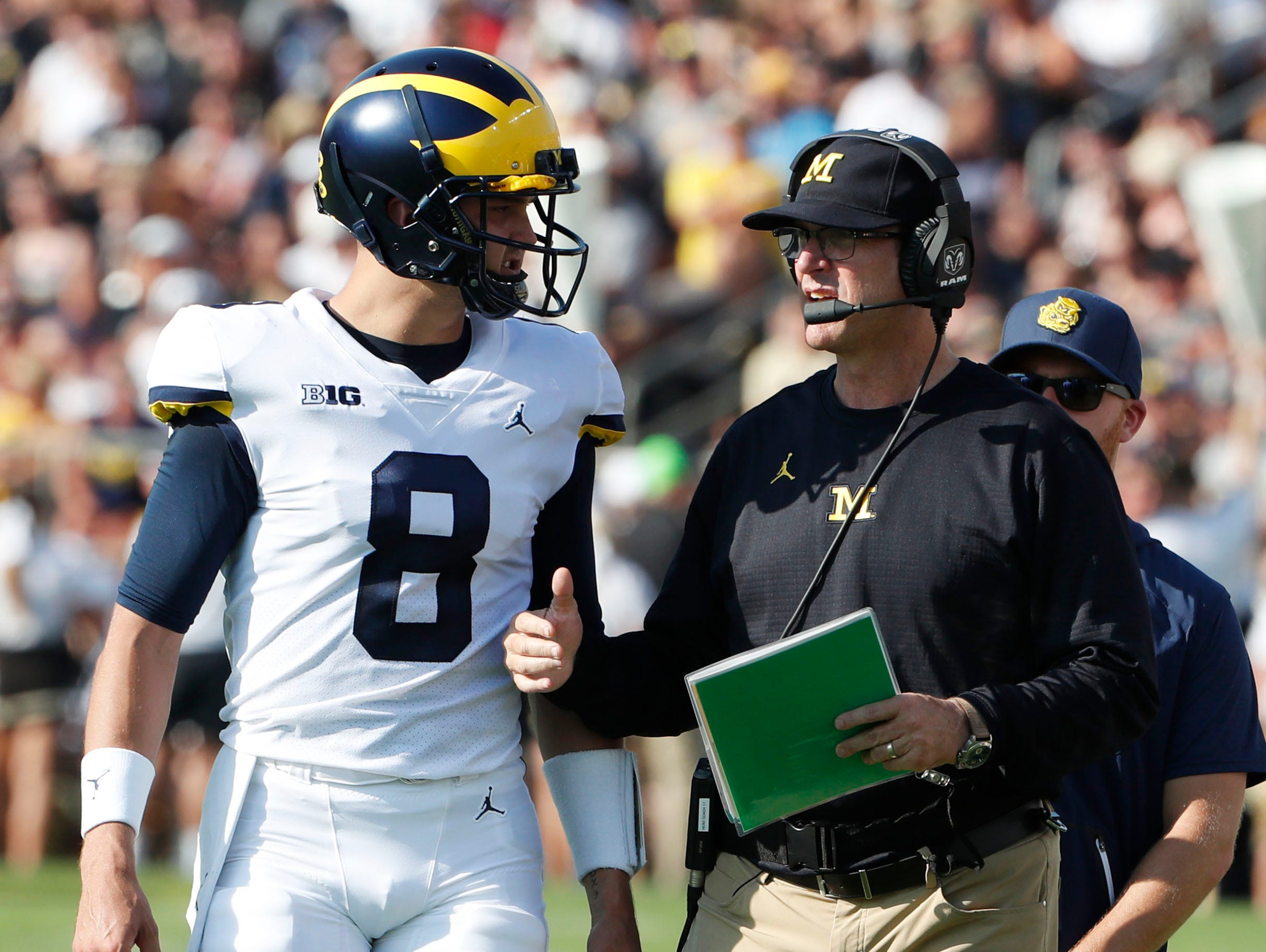 Michigan coach Jim Harbaugh and quarterback John O'Korn.