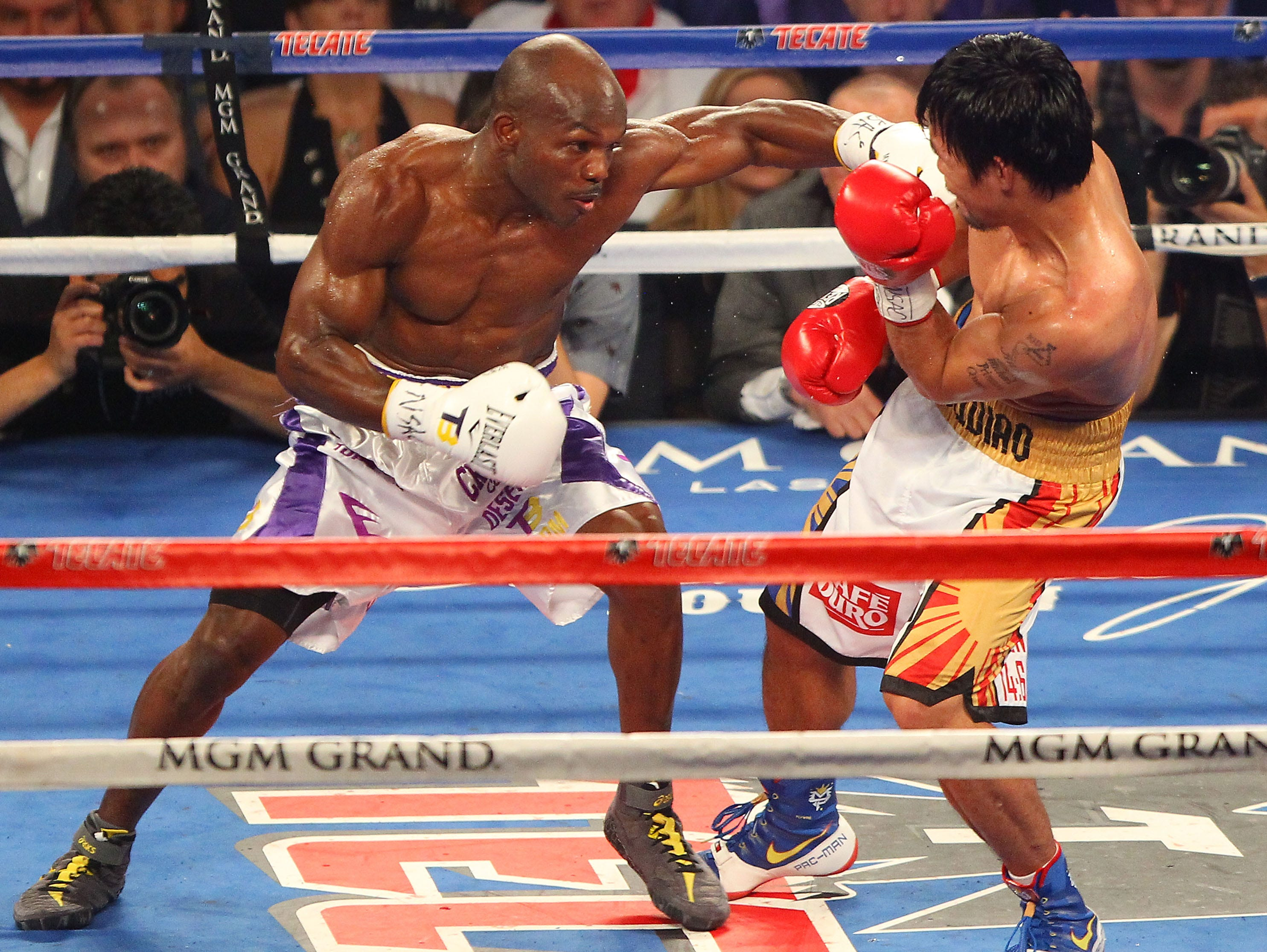 Tim Bradley punches Manny Pacquiao during their fight at the MGM Grand in Las Vegas, April 9, 2016.