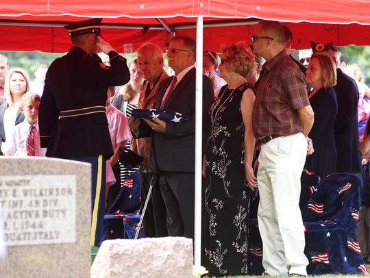 The colors are presented to Eugene Simonds, nephew