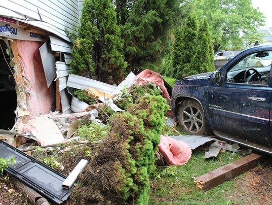 car into house