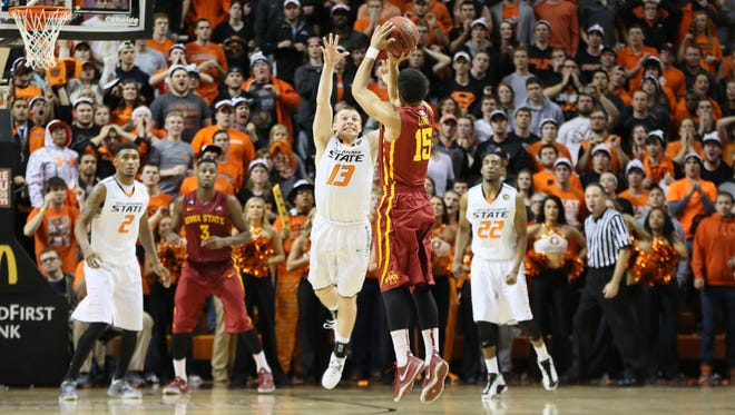 Cyclones guard Naz Long (15) shoots a three point against Oklahoma State. Mandatory Credit: Nelson Chenault-USA TODAY Sports