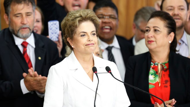 Suspended President Dilma Rousseff speaks to supporters at the presidential palace after the Senate voted to accept impeachment charges against Rousseff on May 12, 2016 in Brasilia, Brazil.