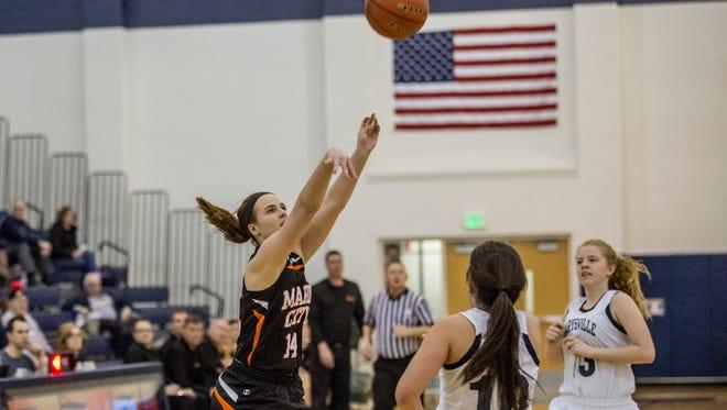 Marine City senior Karyssa Austin takes a shot during a basketball game Tuesday, Jan. 24, 2017 at Marysville High School.
