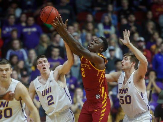 Iowa State freshman forward Cameron Lard battles for