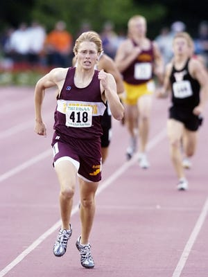 In a 2007 photo, Dan Stockberger, of McCutcheon races toward the finish line for the 800 meter state championship. Stockberger will be honored by his alma mater Friday night for his induction into the Indiana track and field hall of fame.