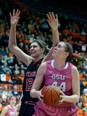 Oregon State's Ruth Hamblin, right, is fouled by Utah's Emily Potter, left, in the second half of an NCAA college basketball game in Corvallis, Ore., on Sunday, Feb. 14, 2016. Oregon State won 72-53. (AP Photo/Timothy J. Gonzalez)