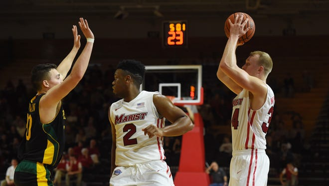 Brian Parker, center, and David Knudsen, right, in Marist's home opener against Vermont in November. The Red Foxes will face Saint Peter's at home on Thursday.