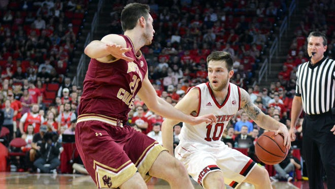 North Carolina State Wolfpack guard Braxton Beverly (10) controls the ball in front of Boston College Eagles forward Nik Popovic (21) during the first half at PNC Arena Tuesday night in Raleigh.