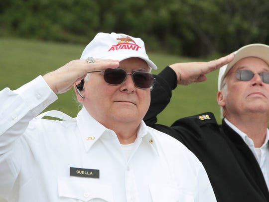 Veterans Joe Guella, on left, and Thomas McBride salute the flag during the flag raising ceremony in observance of Memorial Day at Benedict A. Cucinella Elementary School.