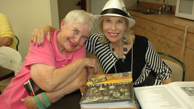 Author Joanne Caras poses with a fan at the Fort Pierce Library during last year's Local Author Book Fair. The third annual Local Author Book Fair on Saturday, March 11, from 10 a.m. to 1 p.m. at two branch libraries (Fort Pierce and Morningside).