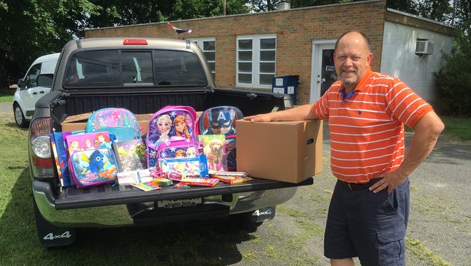Michael Nichols of Cooks Cleaners accepts a donation from Circle D Farm in Bridgeton on behalf of Operation South Jersey's Back to School Drive, which benefits children in need in South Jersey. Cooks Cleaners, 1163 Shiloh Pike, is a drop-off location for donations.
