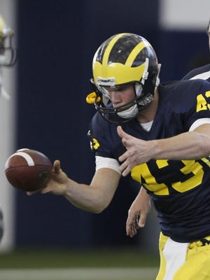 U-M's Will Hagerup punts during spring football practice in 2011.