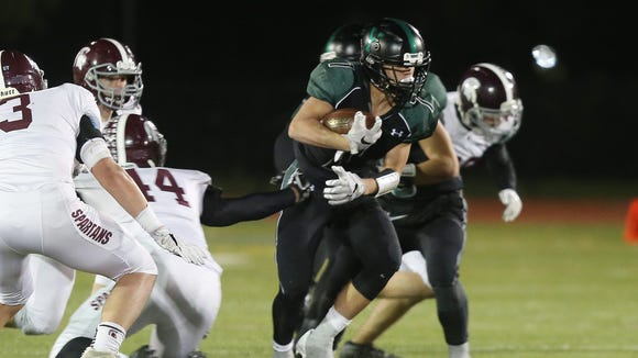 Yorktown's Brandon Meyreles (7) looks for some running