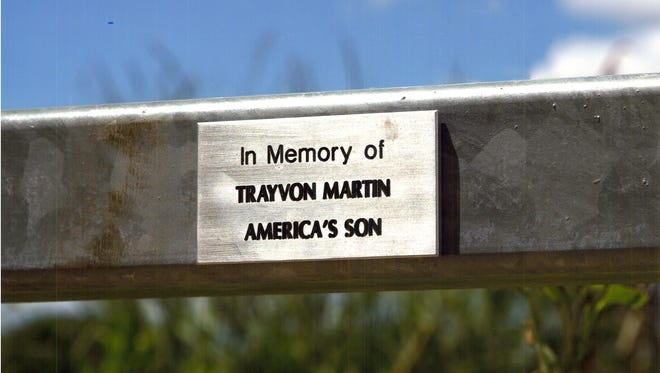 This plaque has gone missing from the footbridge at Gray's Lake.