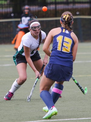 Tower Hill senior Allie Salter and Sanford senior Ana Sarmousakis eye the ball in the first half. Tower Hill defeats Sanford 3-1 at Tower Hill Wednesday to move on to the quarterfinals of the DIAA field hockey tournament.