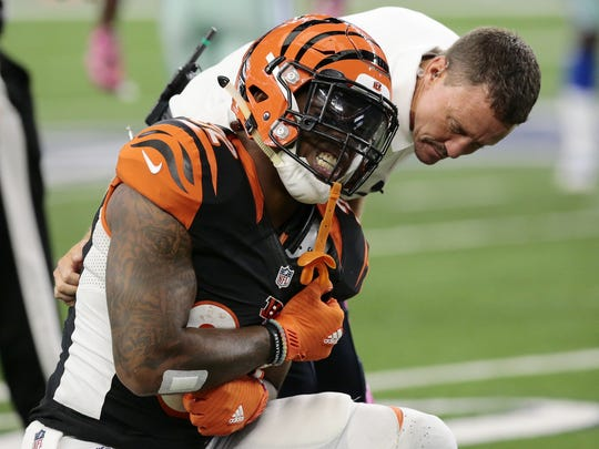 Cincinnati Bengals running back Jeremy Hill (32) holds his arm in pain after a hit in the third quarter of the NFL Week 5 game between the Dallas Cowboys and the Cincinnati Bengals at AT&T Stadium in Dallas on Sunday, Oct. 9, 2016. The Bengals fell to 2-3 with a 28-14 loss on the road.