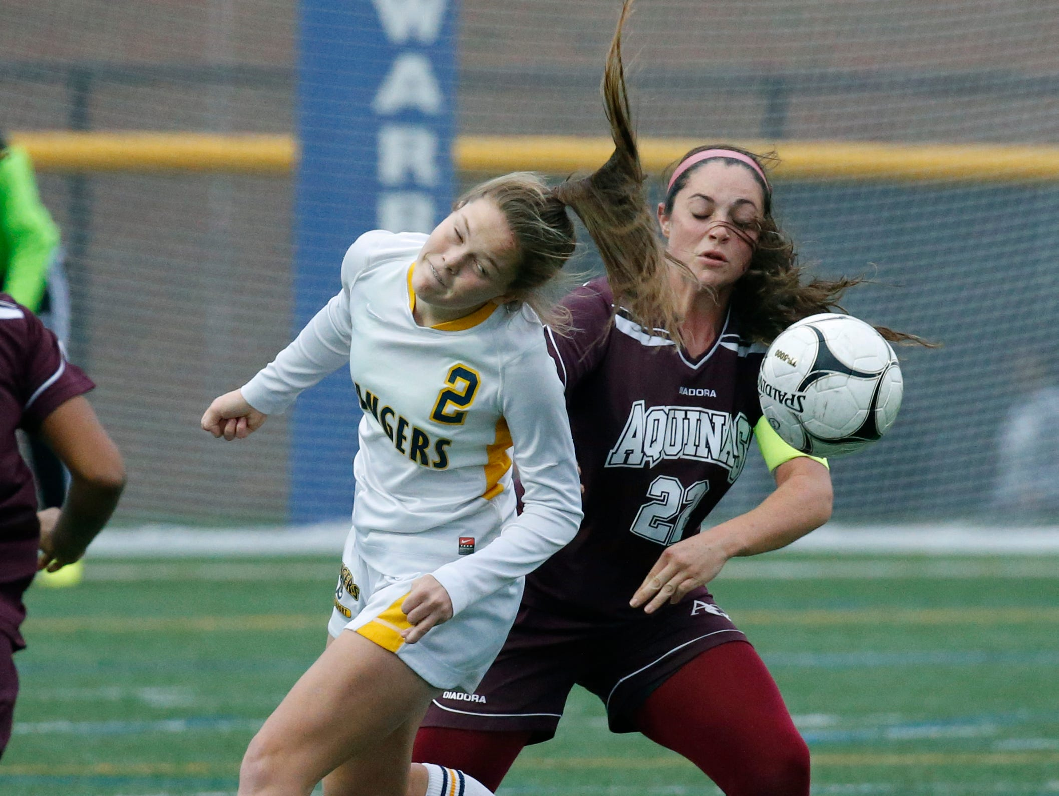 Spencerport's Erin Coykendall and Aquinas' Regan Nugent in the first half at Webster Schroeder High School.