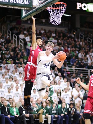 Michigan State's Matt McQuaid shoots a layup during the first half Sunday in East Lansing.