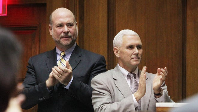 Indiana Speaker of the House Brian Bosma, R-Indianapolis, left; and Gov. Mike Pence applaud as Supreme Court Chief Justice Brent Dickson arrives for the 2014 State of the Judiciary address this month.