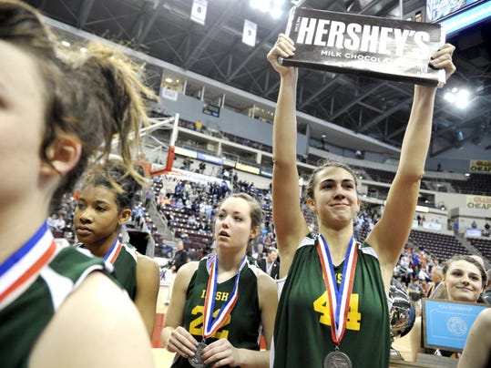 York Catholic's Hannah Laslo holds up a five-pound Hershey's chocolate bar as she and her teammates greet the student section after losing, 45-38, to Bishop Canevin in the PIAA Class AA girls' basketball championship game on Friday, March 22, 2013, at the Giant Center. (DAILY RECORD/SUNDAY NEWS - CHRIS DUNN)