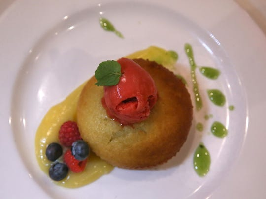 Extra Virgin Olive Oil Cake, with lemon curd, raspberry sorbet and a basil syrup, served for desert at Max of Eastman Place.