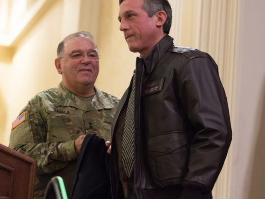 Governor-elect John Carney receives his new military flight jacket at the 17th Annual Senior Leaders Conference at Dover Downs Hotel.
