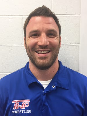 Eric Ring's hiring as Washington Township High School wrestling coach was approved the night of May 23.