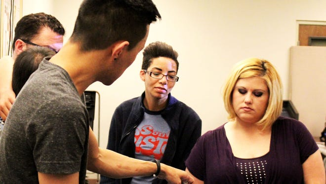DJ Tranzit, an instructor at Scottsdale Community College, teaches students Melissa Micale and Brani Lucero about digital DJ performance techniques.