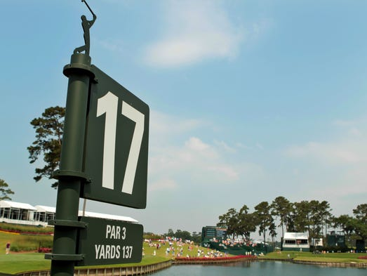 The 17th hole sign welcomes players before their tee shot to the island green at the TPC Sawgrass.