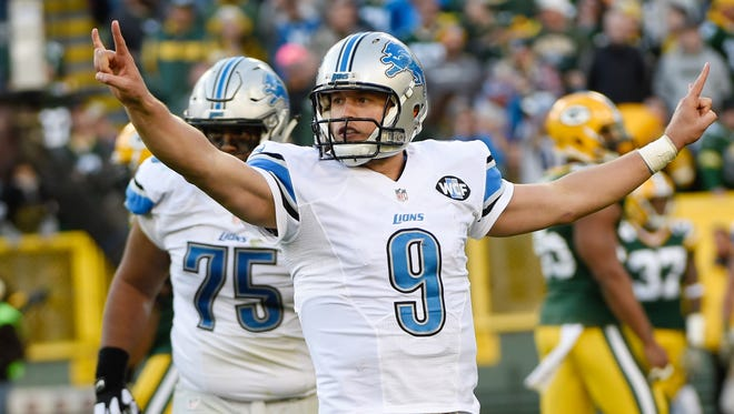 Lions quarterback Matthew Stafford reacts after throwing a touchdown pass in the fourth quarter of Sunday's win in Green Bay, Wis.