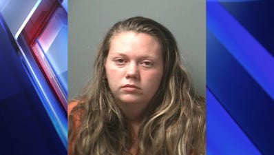 A Bloomington woman was arrested for allegedly killing her husband with her children present.