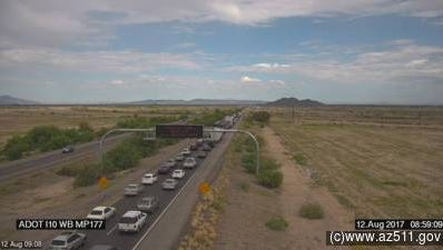 A vehicle fire forced the closure of westbound I-25 Saturday morning, as shown in this ADOT camera at milepost 177.