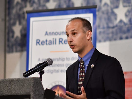 """Lansing Mayor Andy Schor speaks Friday, Aug. 10, 2018, during a news conference at the Lansing Brewing Company, announcing the city of Lansing's partnership with eBay as part of the company's """"Retail Revival"""" program."""