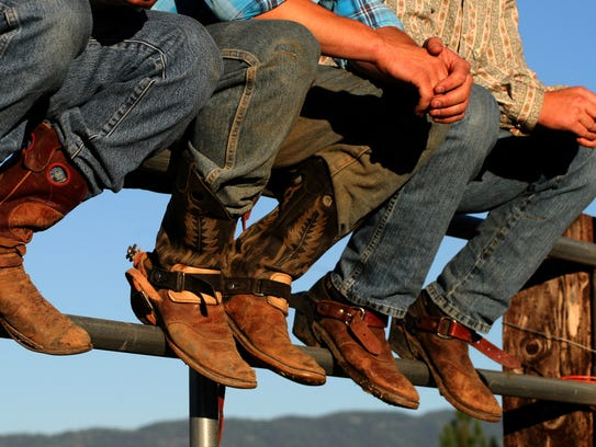 A file photo of cowboys wearing their boots.