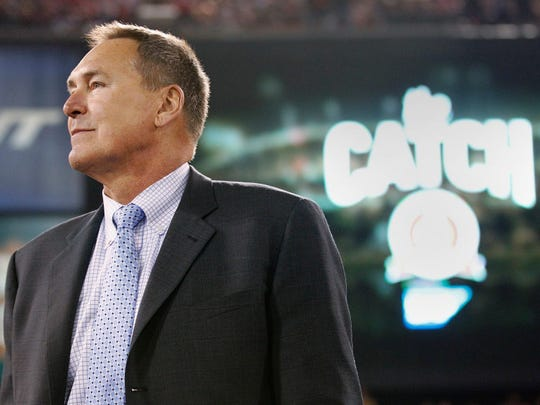 Former San Francisco 49ers receiver Dwight Clark is honored at halftime of a game between the 49ers and Atlanta Falcons in 2013. Clark died after a battle with ALS on June 4, 2018.